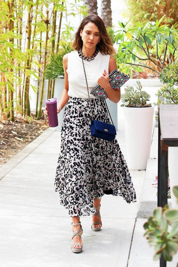 Jessica Alba wears a tank top, thick chain necklace, printed midi skirt,  gray