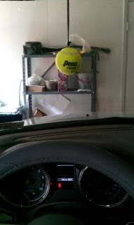 Tennis Ball Hanging From Garage Ceiling To Insure I Don T Part Any