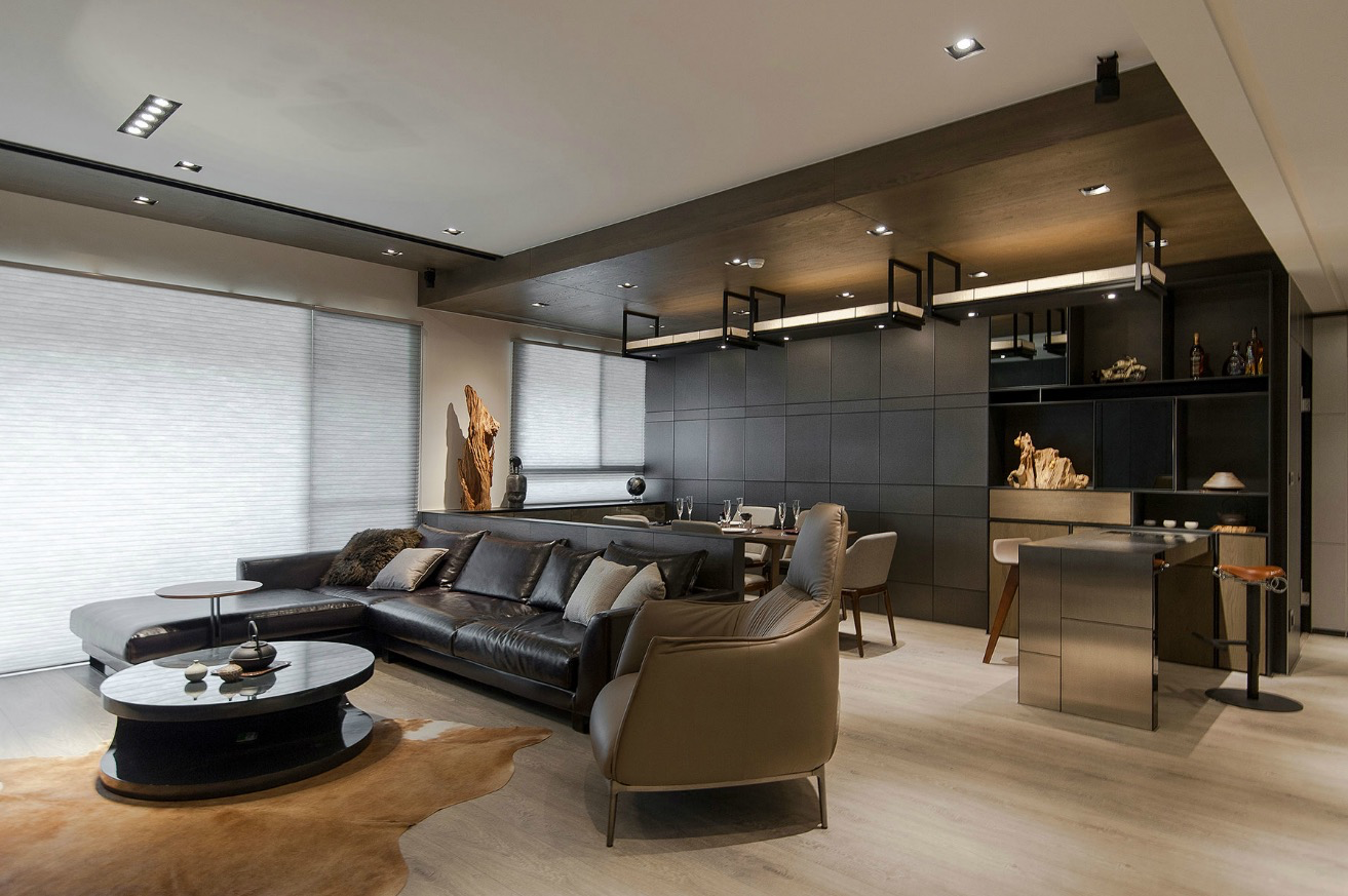 the masculine living room with grey sofas and stylish furnishings   Stone and Wood Make a Dark, Masculine Interior   Masculine ...