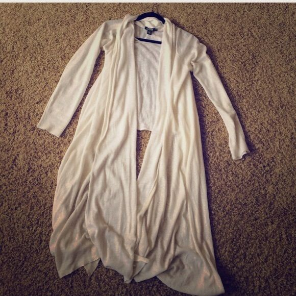 """DKNY Linen Cardigan So pretty!  Shimmery gold cardigan. In excellent condition. Front length is about 49"""", back is about 26"""". Made of 100% linen. DKNY Sweaters Cardigans"""
