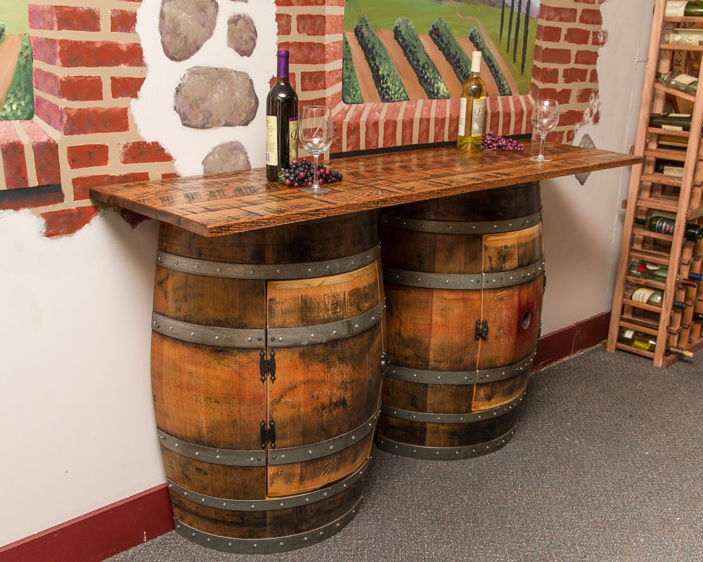 storage oak wine barrels. handcrafted double half barrel bar offers ample storage with two cabinets and one interior shelf each. top made from weathered solid oak. oak wine barrels