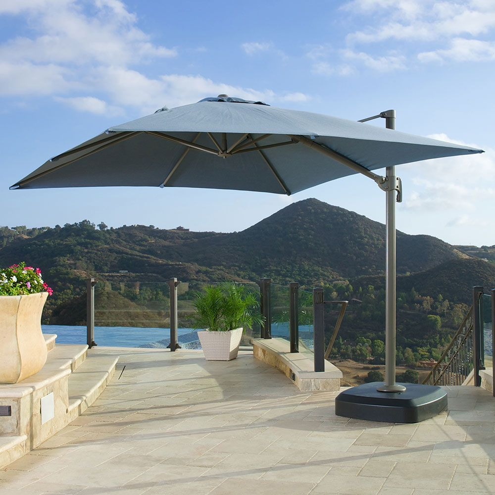 The Portofino 10 Foot Resort Umbrella In Newport Blue Offers Over 100 Square Feet Of Shade 1 199 99 Patio Patio Umbrella Outdoor Patio Furniture Sets