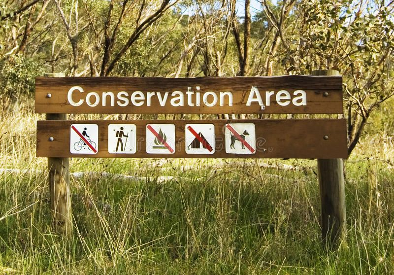 Conservation Area. A wooden sign of a conservation area in