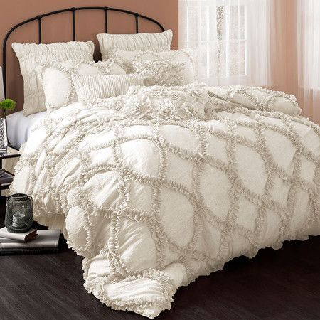 Ivory-hued comforter set with a ruffled design.   Product: Queen: 1 Comforter and 2 standard shamsKing: 1 Comfor...