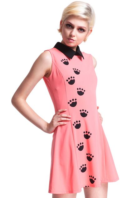 Pink dress, featuring a black collar, sleeveless, black claws print on the front, a big black claw print on the back, and a button on the convergence at the back collar.