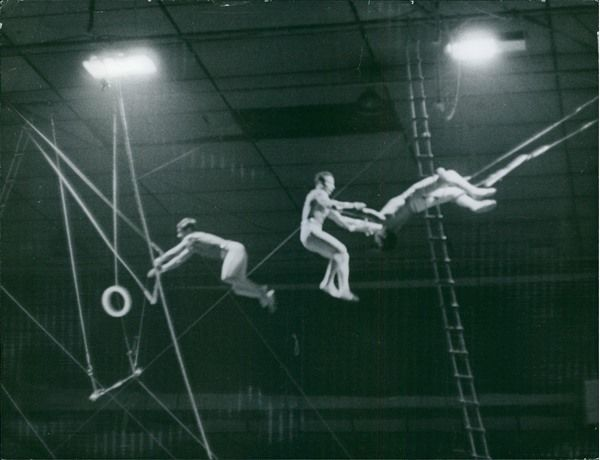 Vintage photo of Performers performing on the circus show, 1969. -