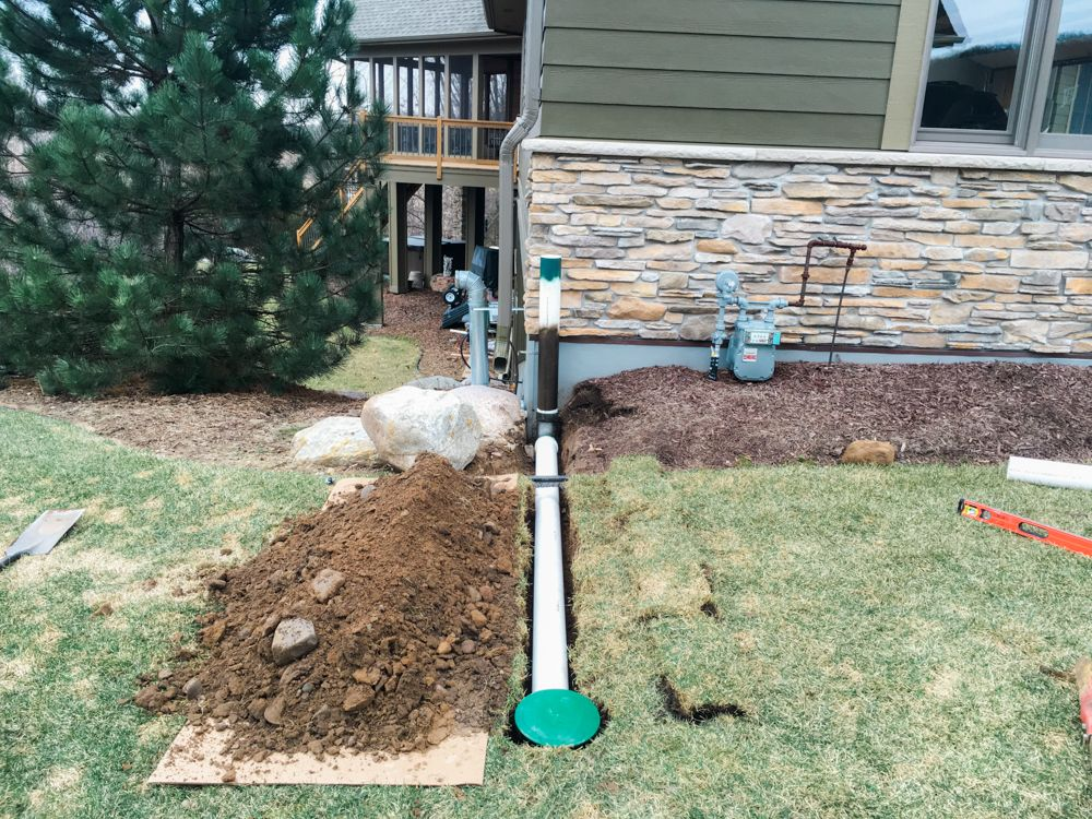 Underground Downspout Diverter Extension Keeps Roof Water Away From Foundation Waterproof Com Downspout Diverter Downspout Drainage Yard Drainage