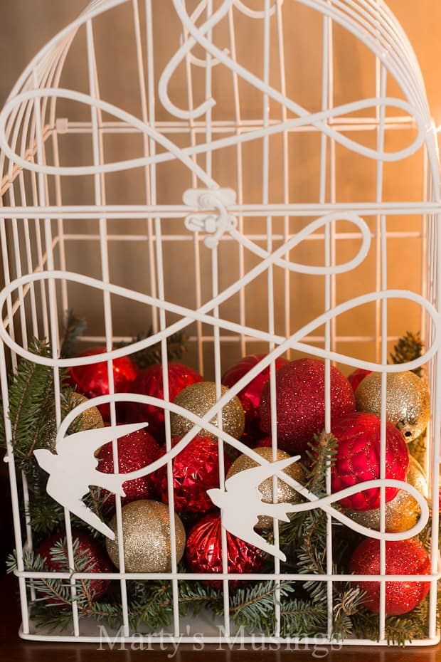 Simple ideas like filling a bird cage with extra ornaments. Perfect cheap Christmas decorations! #martysmusings #christmasdecorationideas #cheapchristmasideas #rusticchristmashome