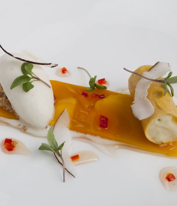 Wonderful tropical flavours combine in this passion fruit parfait recipe--passion fruit, mango carpaccio, lemongrass and lime--to create a spectacular summer dessert. - Richard Corrigan