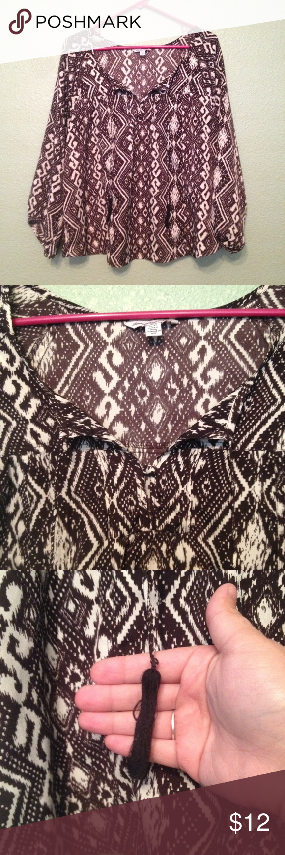 AEO Peasant Top with Split Back and Tassels Black and white ikat design. Split back as pictured. Open peasant neckline with tassels. Flared sleeves! Perfect to pair with a utility vest or on it's own! American Eagle Outfitters Tops Blouses