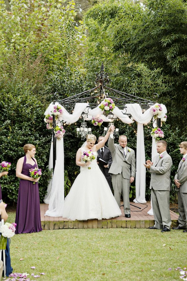 21 Amazing Wedding Arch and Canopy Ideas An outdoor wedding canopy wrapped in white fabric with burst of purple green and white bouquets ... & 21 Amazing Wedding Arch + Canopy Ideas | Outdoor wedding canopy ...