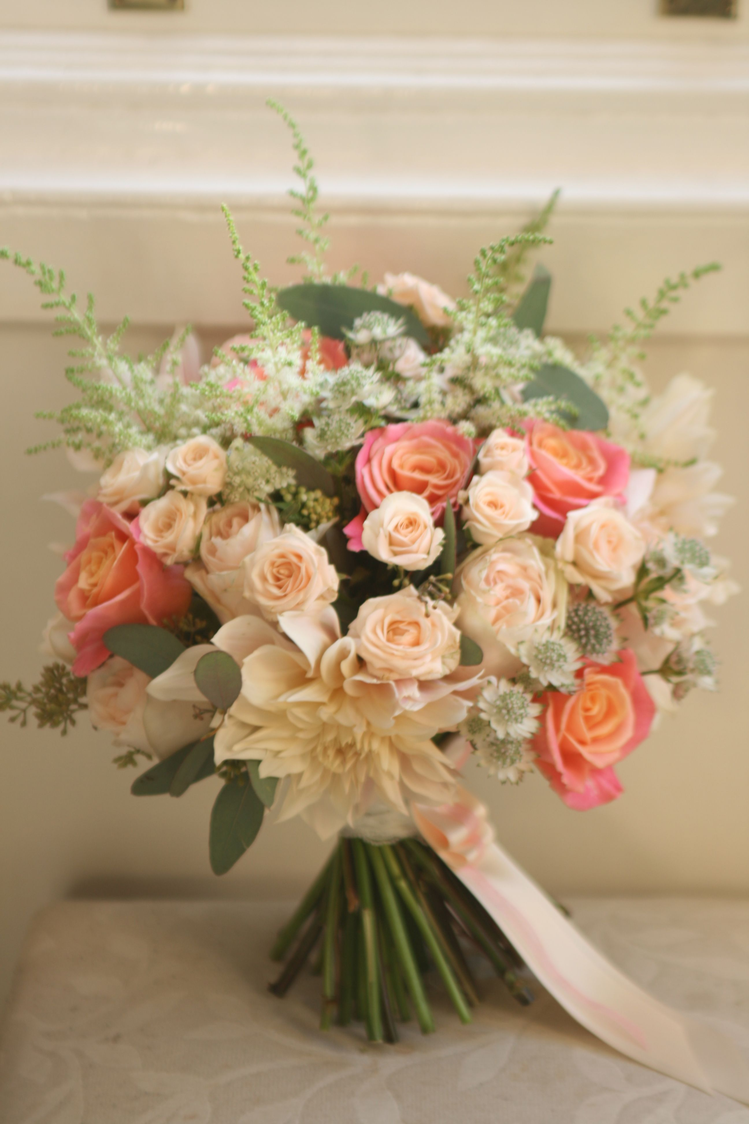 Wedding bouquet in coral and peach with miss piggy roses for Flower sprays for weddings