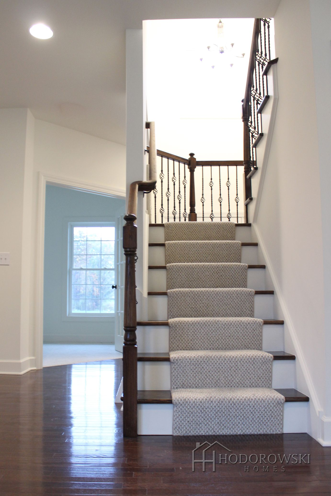 Here is a view of the stairs and foyer from the Living ...
