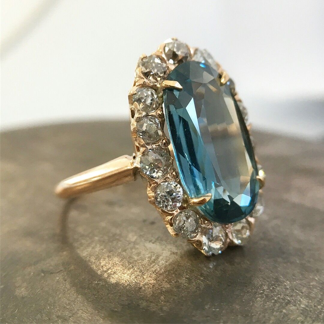This elongated teal colored sapphire and diamond Victorian