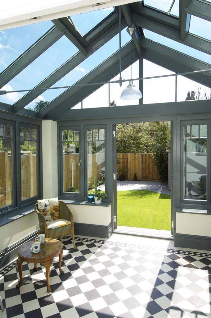 Beautiful contemporary conservatory with chequerboard for Sunroom tile floor ideas