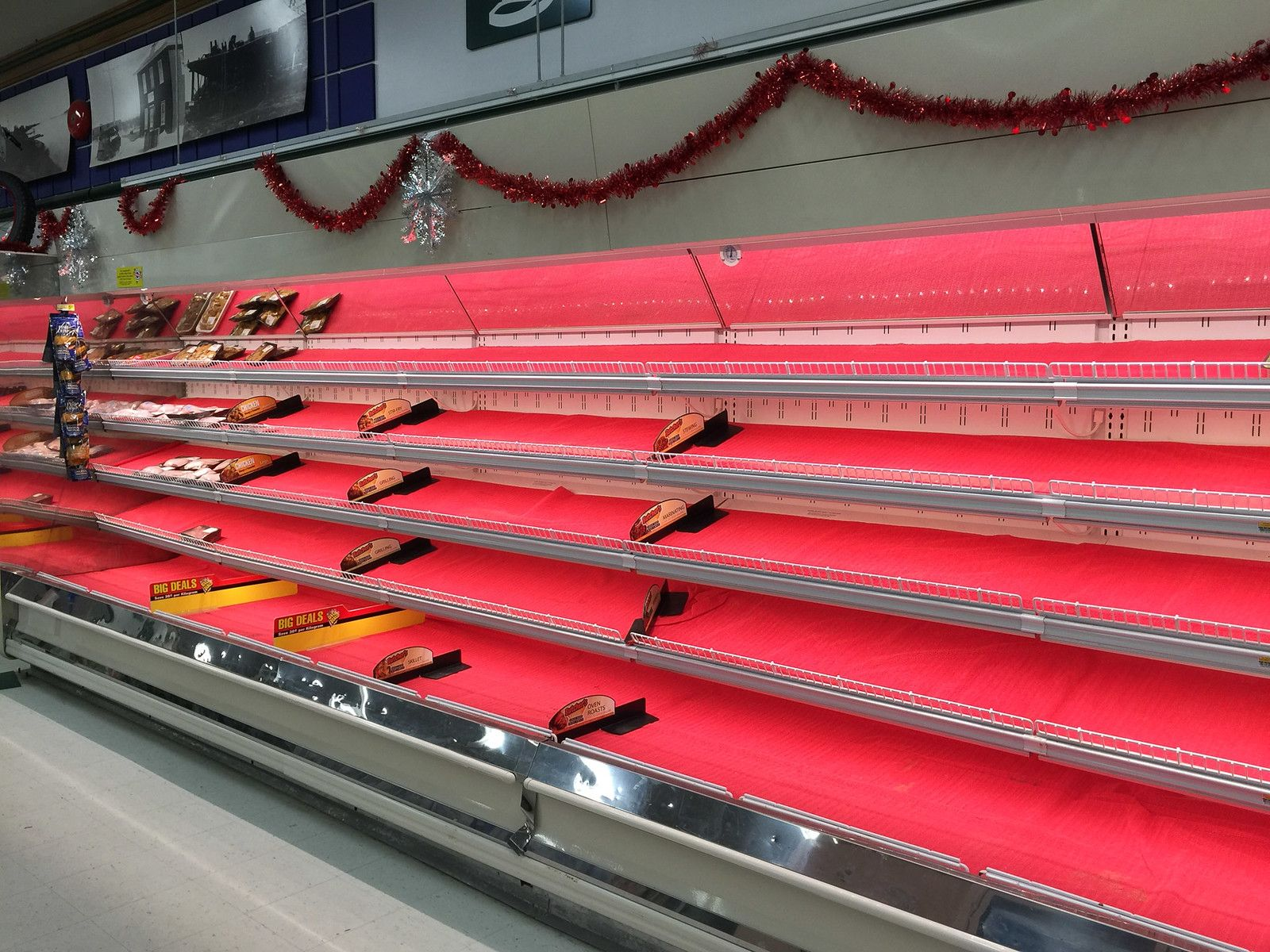 Empty shelves. Aftermath of half price meat sale at Moosonee Northern store 2015 December 24th.