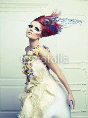 Love the contrast between the light somewhat whimsical dress and the bold colorful makeup and hair