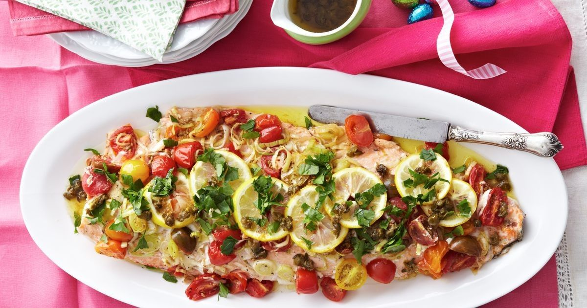 Baked Atlantic salmon with zesty caper sauce is an ideal addition to a special lunch menu.