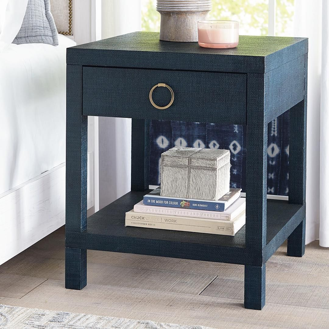 Navy raffia bedside table with a brass pull donut mind if we do