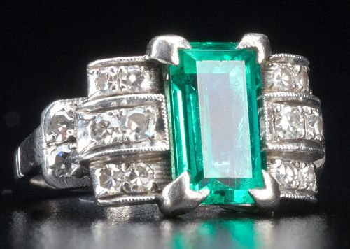 Art Deco Columbian emerald and diamond pt. ring. Clear baguette-cut emerald, approx. 1.75 cts., flanked by curved rows of circular-cut diamonds, approx. .30 ct. TW. Size 5 1/4.