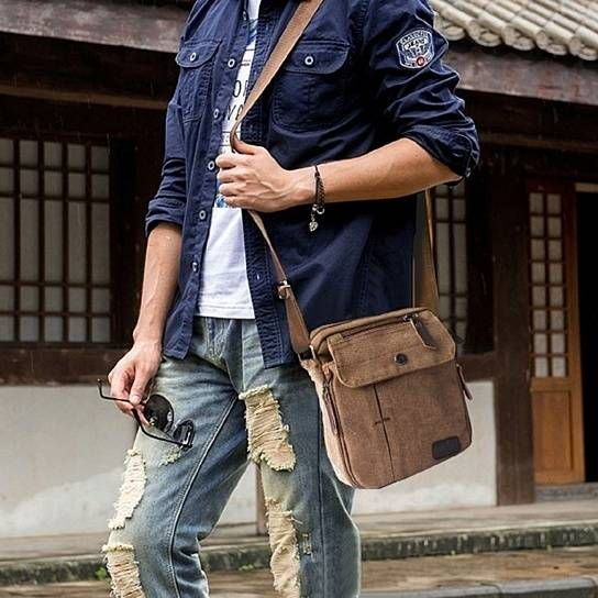 ae1efa5395 This Multifunctional Canvas Traveling Bag is an all-round great bag for  everyday use.  nbsp Made from heavy duty canvas and featuring multiple  pockets