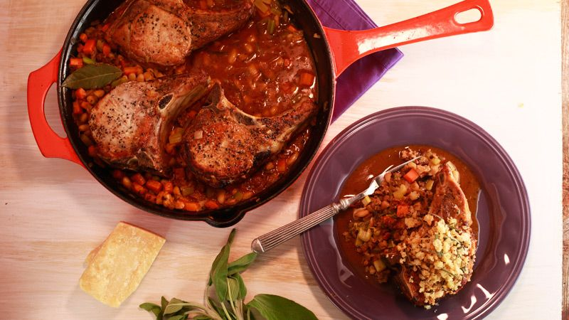 Pork Chops with White Beans and Italian Sausage - full of fresh sage, thyme, rosemary, veggies, Parmigiano-Reggiano cheese, and white wine. Let us know if you try Rachael Ray's recipe!