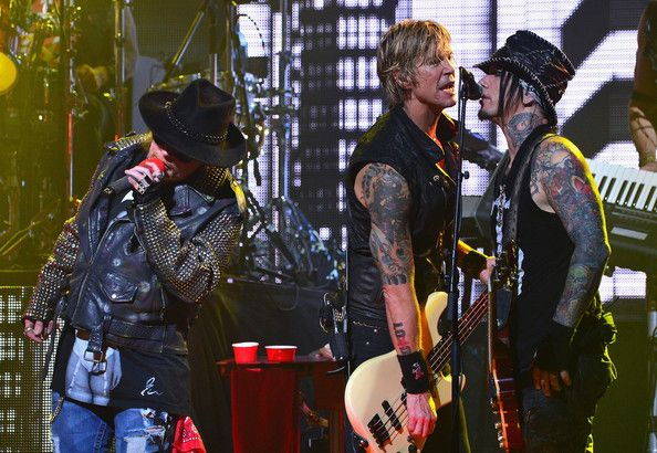 Duff McKagan Photos Photos - (L-R)  Singer Axl Rose and bassist Duff McKagan and DJ Ashba perform onstage at the 6th Annual Revolver Golden Gods Award Show at Club Nokia on April 23, 2014 in Los Angeles, California. - 6th Annual Revolver Golden Gods Award Show - Show