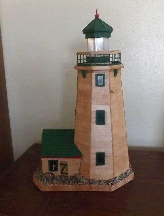 Light up lighthouse made out of popsicle stick by RoseAnDonCrafts