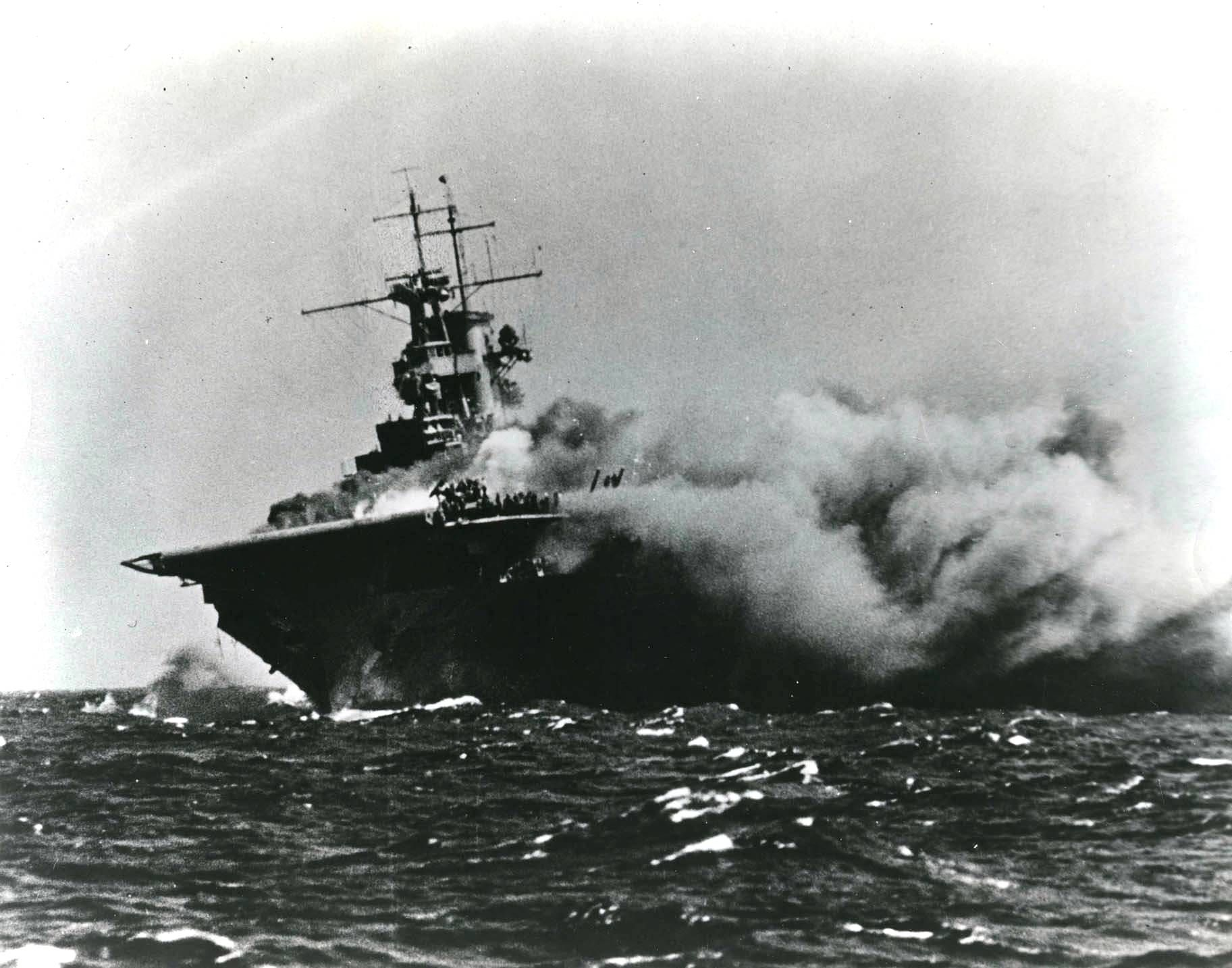 Carrier USS Wasp burning and listing after being torpedoed by Japanese submarine I-19 in the South Pacific, 15 Sep 1942. (US National Archives)