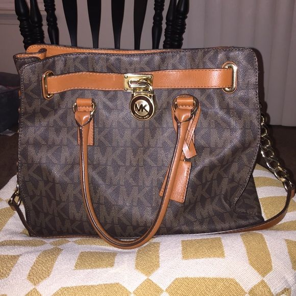 3e9480f66eed Michael Kors Handbag Michael Kors Handbag. Very good condition, worn  lightly. Small scratch by the locket in 3rd picture. Slightly worn handles  in last ...