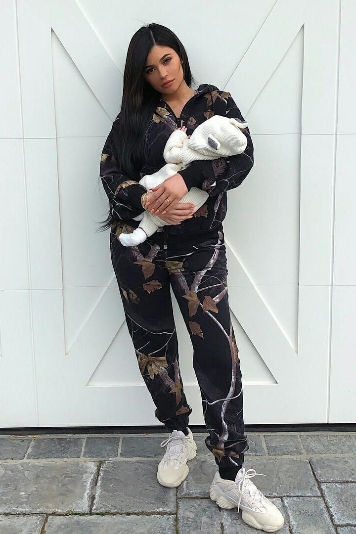 Kylie Jenner wearing Yeezy 500 Desert Rat Sneakers in Blush, Alexander Wang  Winter Camo Fleece Pants and Alexander Wang Winter Camo Fleece Hoodie