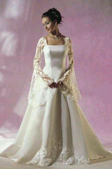 "A modernized take on the classic ""Celtic/Renaissance"" wedding gown ..."