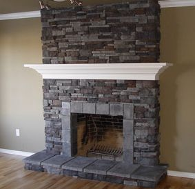 white mantel on stone fireplace