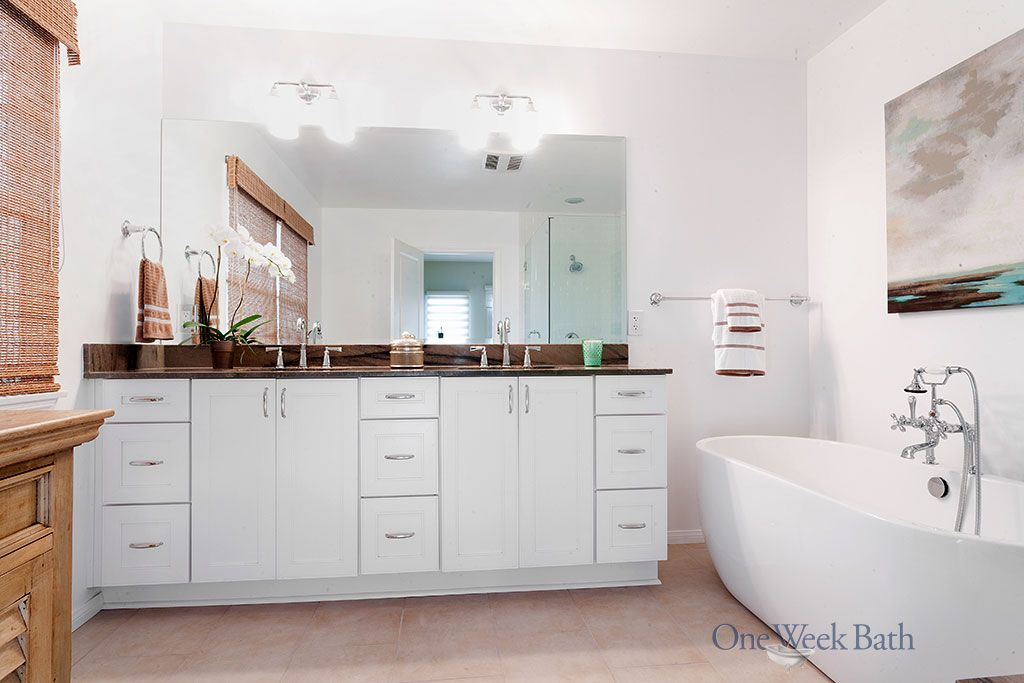 Dual sink white vanity with marble counter top #OneWeekBath #Spa