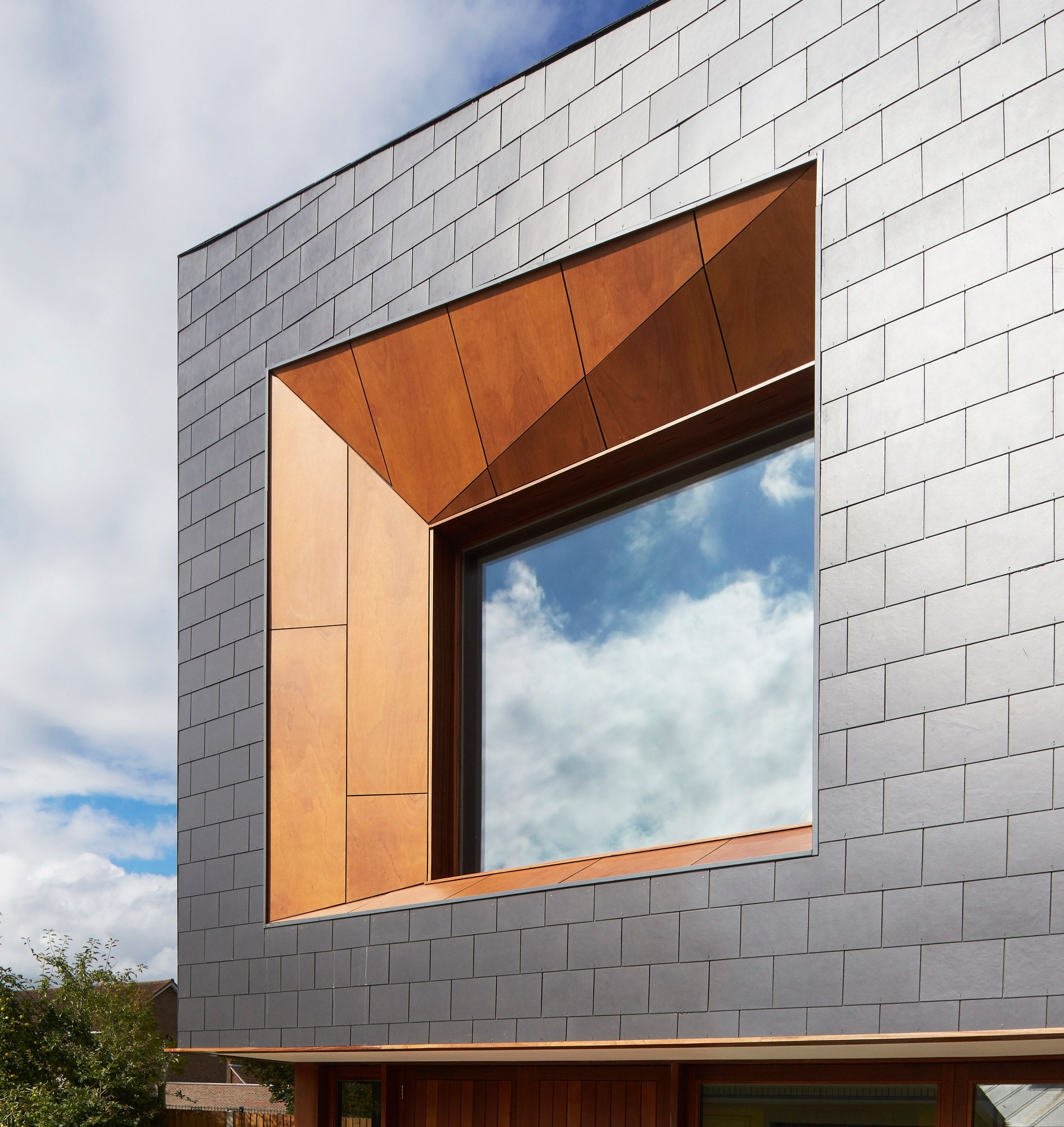 Ayre chamberlain gaunt completes angular youth centre in for Window cladding