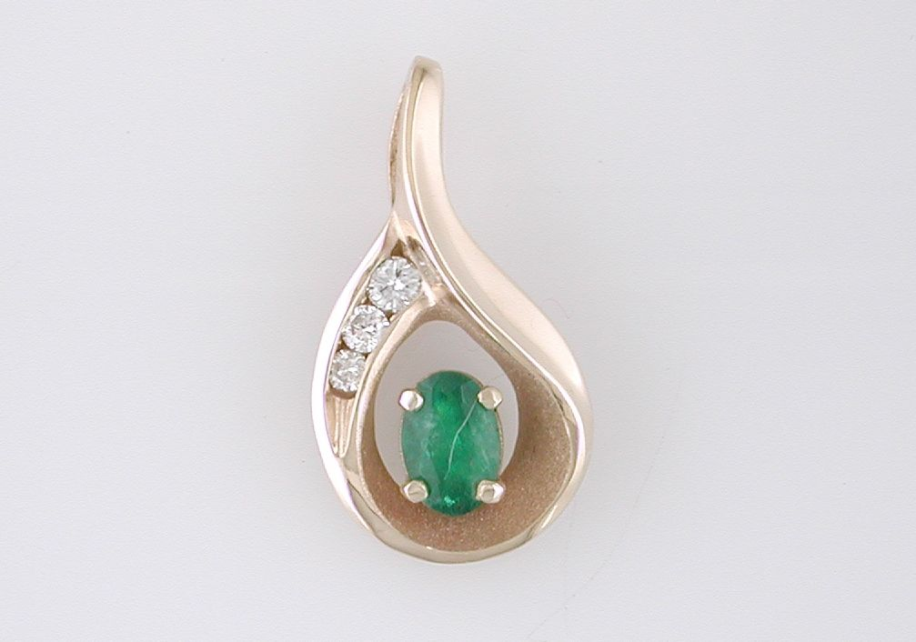 14k yellow pendant with Emerald and diamonds.