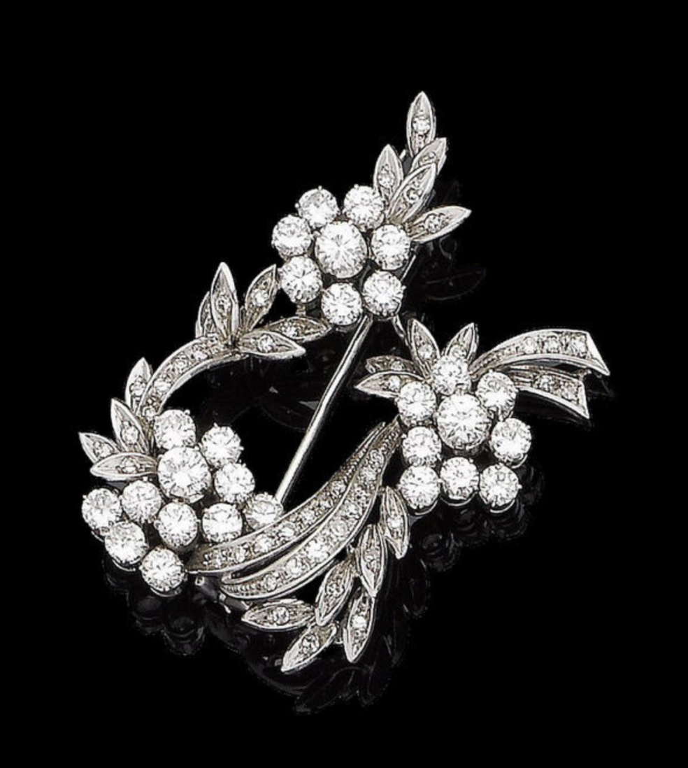 A diamond spray brooch Of floral and foliate design, the curved stems and leaves set with single-cut diamonds, the flowers with brilliant-cut diamonds, diamonds approx. 3.60cts total, length 4.8cm