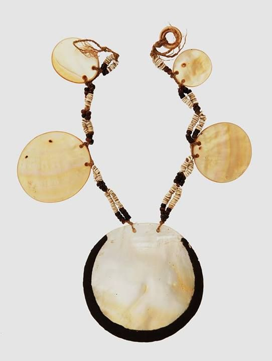 """Source: Ethnic Jewelry and Adornment FB page and Joost Daalder: """"SOLOMON ISLAND ADORNMENT Hand cut shell disc and trade beads necklace leading to a large central disc with gum decoration to edge. Malaita, Solomon Islands. Collected 1950. L.210mm, W.230mm. To be sold by Webb's, Auckland, New Zealand."""""""