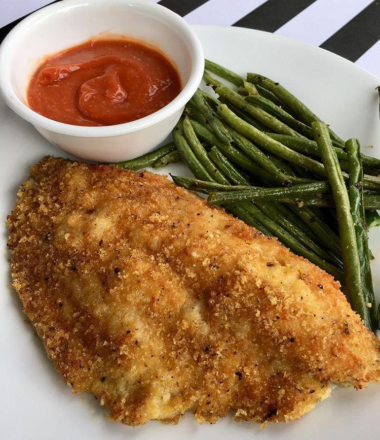 Air fried catfish with a pork rind crust, crispy green