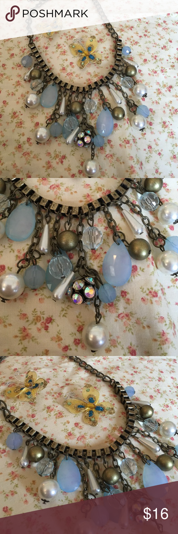 Touch of Blue Necklace Very cool statement piece. Blue crystals, pearls, teardrops and balls of gold. You know you want this! Jewelry Necklaces