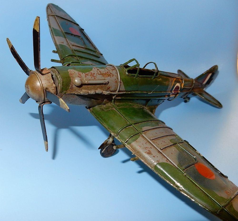 spitfire ornament. vintage ww2 spitfire aeroplane old metal toy plane - seen action man cave ornament y