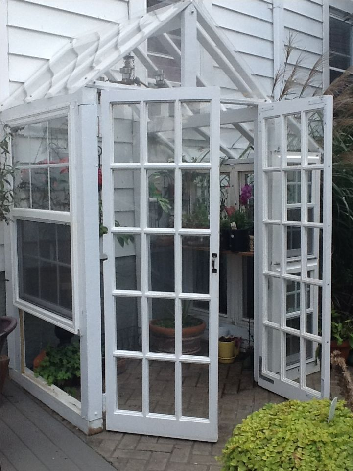 Greenhouse made from recycled windows and doors with for Reclaimed window greenhouse