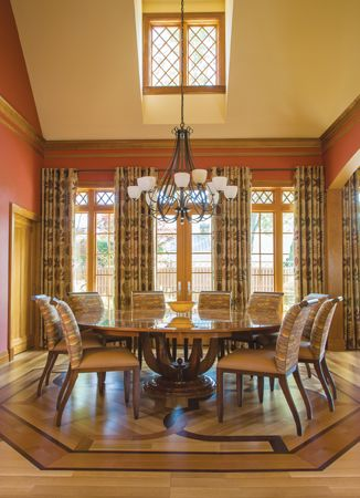 The #custom #dining #table, picked out by Skip Sroka, has an ornate top that combines six types of wood. #interior #design