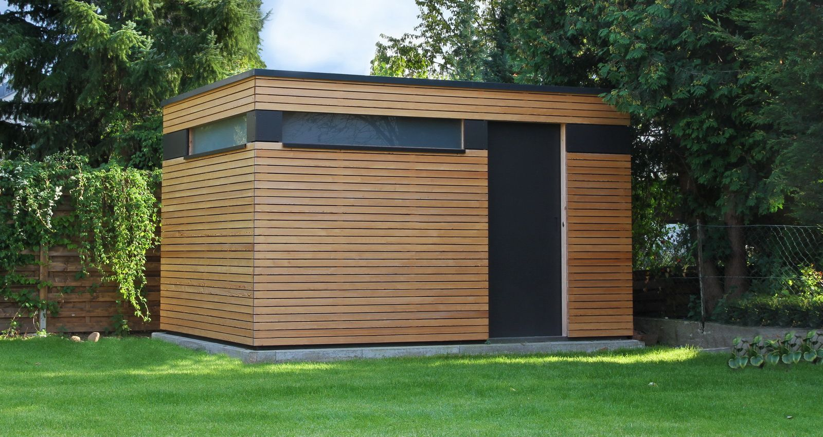 Wooden garden shed in contemporary design with small