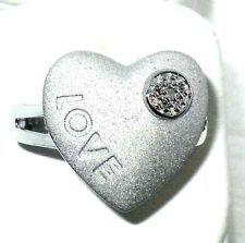 http://www.ebay.com/itm/221247181669?ssPageName=STRK:MESELX:IT&_trksid=p3984.m1558.l2649  Love Diamond Accent Round Sterling Silver Heart Ring size 8