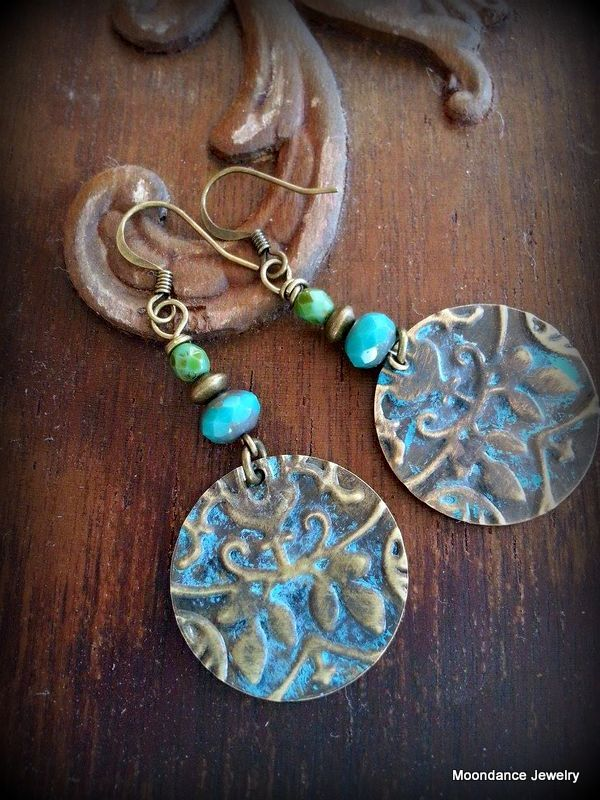 My first Sunday Earring Challenge. Embossed brass using a Vintaj folder and patina'ed with Guilder's Paste. Finished with Czech glass beads and brass ear wires.