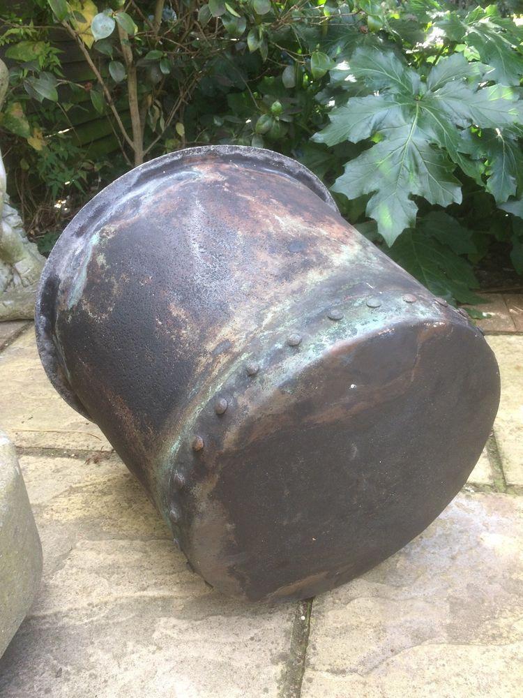 A vintage reclaimed studded copper verdigris copper pot