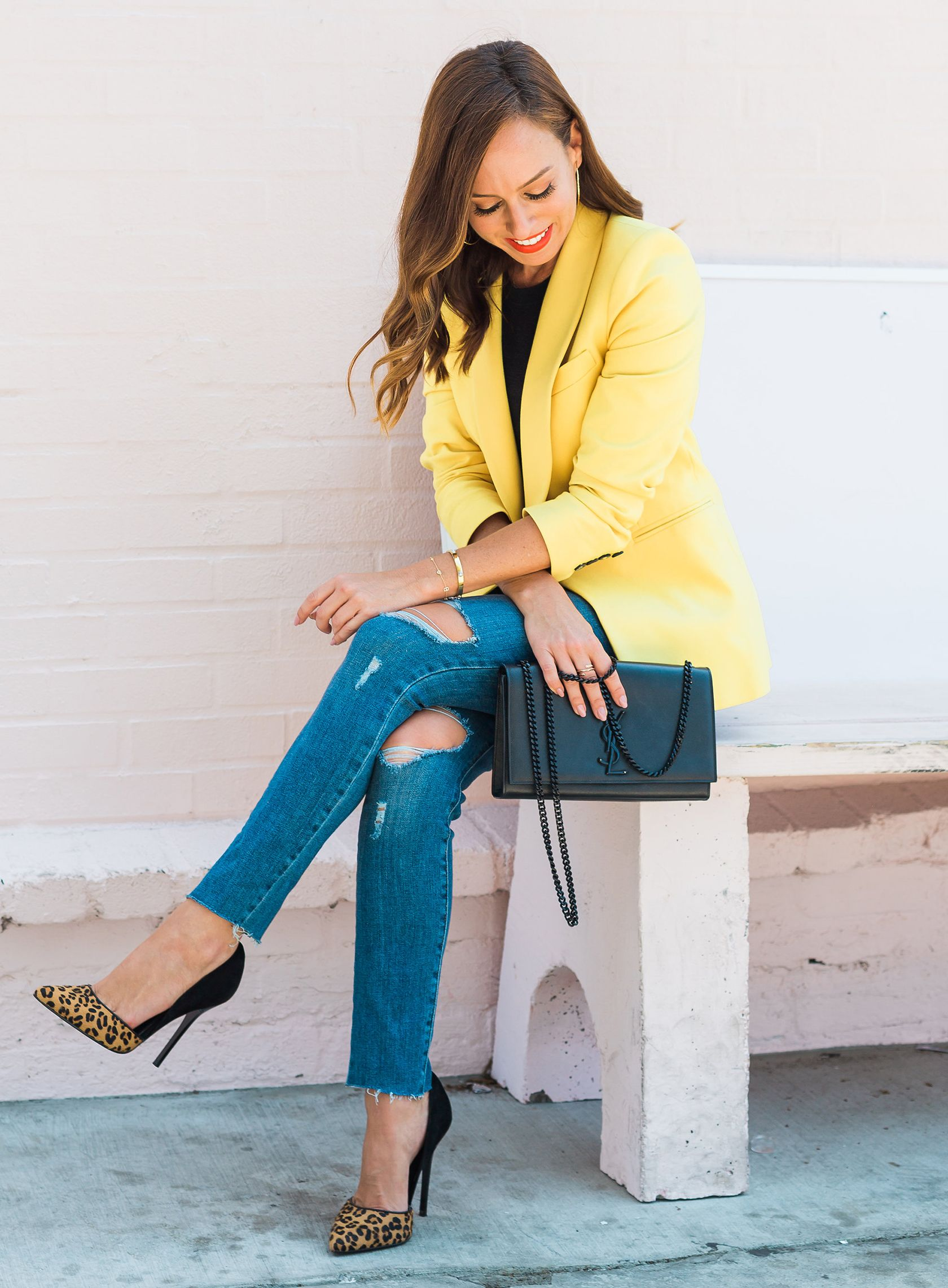 4b926e8a87861 Sydne Style shows how to wear the gen z yellow trend in bright blazers for  fall  blazers  yellow  jeans  leopard  sydnesummer
