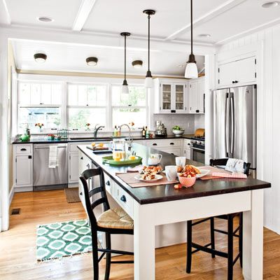 The 10 Foot Island Is An Open Invitation To Gather With A Prep Sink At One End And Seating Kitchen Remodel Countertops Simple