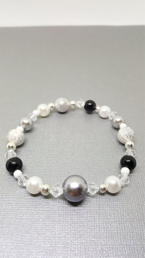 Check out this item in my Etsy shop https://www.etsy.com/ca/listing/517169541/silver-beaded-bracelet-beaded-bracelet